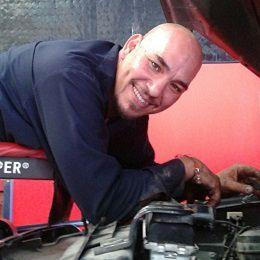 Auto Shop Owner and Master Technician Carlos Rodriguez