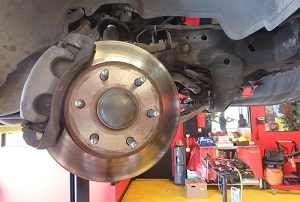Rear pad rotor replacement at ASE brake shop